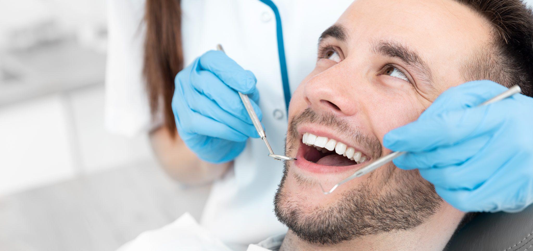 Young Man At The Dentist